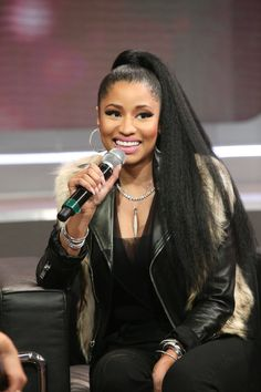 The beauty of Nicki Minaj's super-high, extra-long pony is that it keeps her hair off her face, yet having the tail swept over her shoulder gives the illusion of a down style too. The easiest way to execute it: brush hair up into a super tight high pony then flat iron the tail to make it pin straight. Finish by wrapping a small section of hair from the tail around the base and pinning in place.    - Cosmopolitan.com
