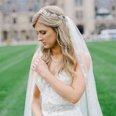 Cathedral-Length Bridal Veil..Rebekah accessorized her Sophia Moncelli gown with a subtle necklace, gorgeous headpiece and a beaded, cathedral-length veil from Kleinfeld bridal salon in Manhattan. Her beauty look was provided by Too Faced Cosmetics and DryBar.
