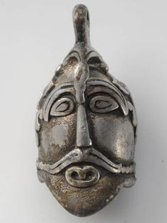 Viking silver pendant shaped as a human head.    From the History Museum in Stockholm.