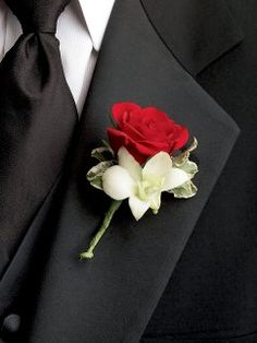 Ruby Rose & Orchid Buttonhole£16.00This splendid rose and orchid buttonhole is sure to catch the eye. Weddings are the perfect occasion to add a touch of glamour to the proceedings and this ruby rose and white orchid combination is a classic way to make anyone feel special.Featuring a red spray rose and white dendrobium orchid with pittosporum. This buttonhole measures approximately 8cm (w) width by 10cm (l).