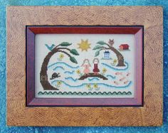 Carriage House Samplings Island Sisters - Cross Stitch Pattern. Model stitched on 40 Ct. Creme Brulee linen with Needlepoint Inc. Silks. <br /> DMC conversions