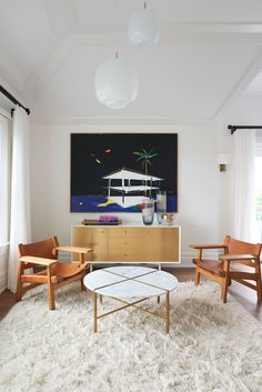 Egg Collective custom Julie Credenza in a Bridgehampton home by Timothy Godbold with a painting by Harold Ancart