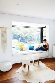 Home tour: Scandi minimalist style in a white and bright home with pops of color. Love this reading nook in he window seat! Photography by Cath Muscat. Styling by Vanessa Colyer Tay. From the February 2017 issue of Inside Out Magazine. Style At Home, Window Benches, Window Seats Bedroom, Bedroom Windows, Bright Homes, Luz Natural, Natural Light, Banquette, Living Spaces