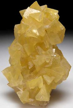 AF166 - Smithsonite $ 2500 SOLD Tsumeb, Namibia small cabinet - 8 x 5.5 x 3 cm -  Cluster of large light yellow Smithsonite crystals. Crystals reach 2cm in size, no damage and no matrix.