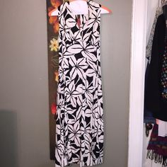"""price drop 100% SILK floral print dress Black/cream colored floral print been worn maybe four times.  100% silk. I'm about 5' 5"""" and it hits at the knee. Fitted top flowy bottom. Originally purchased at Neiman Marcus. Size marked 4. The back is gorgeous with keyhole coming to two buttons and gathered silk to close. The front fits on the bust halter style around the neck to close in the back. I love this dress but can no longer fit in it  PRICE DROP Dresses"""