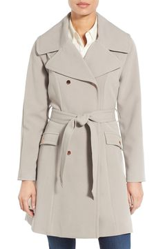 Crafted from lightweight, water-repellent gabardine, this elegant double-breasted trench coat tackles soggy days in style thanks to chic details like a broad collar, fit-perfecting waist tie and a storm flap in back. Rose gold hardware adds extra flair to this everyday essential.