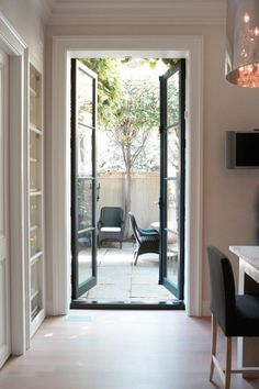 I do love pretty doors leading out to patios and backyards.... via @Emma  - The Marion House Book by House and home Michael Alberstat photo