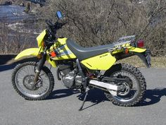 Finding an Adventure Motorcycle when you have short legs can be frustrating. We have compiled a list of 10 adventure motorcycles for short riders that might work for you. Suzuki Motocross, Enduro Motorcycle, Moto Bike, Motorcycle Helmets, Dr 650, New Motorcycles, Dual Sport, Dirtbikes, Trail Riding