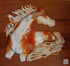 Clay horse sculpture on re claimed wood panel. Original Sculpture