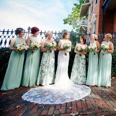 @lynsgaga bridesmaids in a mixture of mint blue and floral printed bridesmaid dresses from David's Bridal