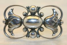 """intage floral Georg Jensen sterling silver brooch #236A. Measures 1 1/2"""" wide by 1"""". Bears impressed company marks for post 1945."""