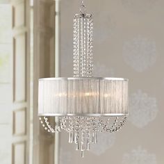 This shade chandelier radiates when illuminated with clear crystal beads and a silver finish.
