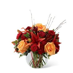 The Autumn Splendor Bouquet displays hues of orange and burgundy flowers and is designed in a keepsake vase and hand delivered by a local florist. Burgundy Flowers, Orange Roses, Fall Flowers, Wedding Flowers, Fall Wedding Centerpieces, Floral Centerpieces, Cheap Backyard Wedding, Pumpkin Bouquet, Thanksgiving Flowers