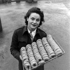 the history behind National Doughnut Day: Red Cross Clubmobile Girl Katherine Spaatz serving doughnuts.