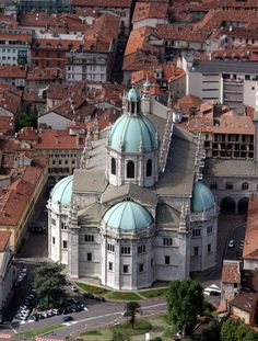 The Cathedral (Duomo) in Como, near Lake Como, Italy with beautiful bronze domes.