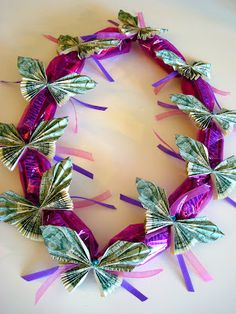 Lei made from dollar bill butterflies and candy bars. Cute from Once Upon A Pink Moon.