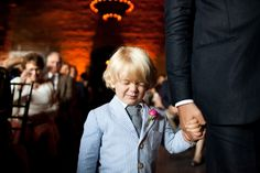 One of the world's most stylish (and shy) ring bearers. Photo by Dave Robbins