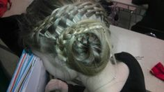 This updo starts off with a five strand waterfall that gets all the hair to one side, then I put the hair left that wasn't part of the waterfall in a ponytail, then I French braid taking the waterfalled strands and the hair from the ponytale and then I wrap it up in a bun. All hair on this page is done by me Osman Salam.