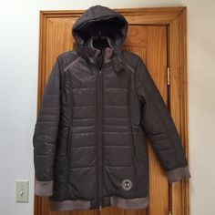 Mocha Insulated Under Armour Puffer Mocha (almost reads as gray) with dark purple interior, rubbed collar, cuffs and hem, great seam lines, longer silhouette, removable insulated good, secure pockets, stand-up collar, excellent condition, super warm & cute Under Armour Jackets & Coats