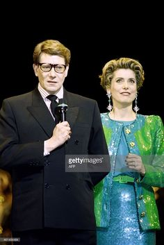 French designer Yves Saint Laurent (L) and French actress Catherine Deneuve attend on February 3, 1992 the show celebrating the 30 years creation anniversary of the Yves Saint-Laurent House at the Bastille Opera in Paris. AFP PHOTO PIERRE GUILLAUD