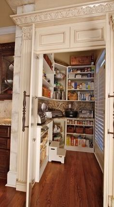 Love the entrance on this Food Storage Pantry! Also like small appliances here to keep counters uncluttered!