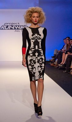 Love this form fitting dress with the punch of red.  by Mondo from the Project Runway All Stars episode 11.