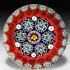Mike Hunter 2015 close concentric millefiori with daisies and roses glass paperweight. by Twists Glass Studio