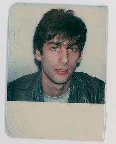 neil-gaiman:  There aren't a lot of photographs of me aged 23 as a starving young journalist in London. But I just noticed that I had this in the office here, and scanned it from my British Library Reading Room card (they would cut the old card in half when they gave you a new card and give you the photo back). I was not even wearing black yet. Even the leather jacket was grey.   Putting this up on Twitter, so I thought I'd reblog it here too. So long ago.