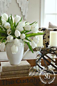 Vignette for Living room side baord.  Cover books, buy ball from Marshalls, candales for silver pillars, on silver platter