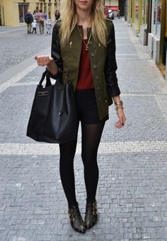 Black tights, studded ankle boots, and shorts; burgundy t-shirt, olive jacket with leather sleeves