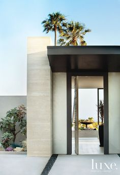 Architect Russell Shubin marked the entry of this modern Pacific Palisades house with a board-form concrete wall.