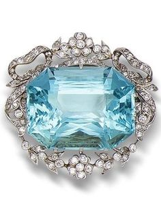 A belle Époque aquamarine and diamond brooch/pendant, circa 1905. The large rectangular mixed-cut aquamarine within a floral, foliate and tied-ribbon surround of single-cut diamonds, mounted in silver and gold, diamonds approximately 1.00 carat total, later brooch fitting, width 3.0cm. #BelleEpoque #brooch #pendant
