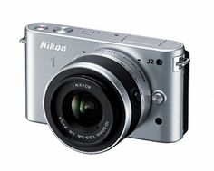 Nikon 1 J2 10.1 MP HD Digital Camera with 10-30mm VR Lens (Silver) by Nikon. $546.95. From the Manufacturer                   Like all Nikons, Nikon 1 J2 captures sharp, noise-free images even in low-light situations. With built-in modes for Night Portrait and Night Landscape and an ISO range from 100 (for very bright days) all the way up to 3200 (for the dimmest conditions) your shots will always shine.     Impress even yourself Endless creativity and inspiration Nikon 1 J2'...