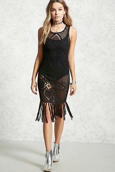 A sleeveless crochet dress featuring an open-knit design, scoop neck, and tasseled trim along the bottom hem.