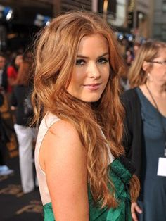 Auburn-haired actress Isla Fisher's long locks have a glamorous hint of red.    Read more: Best Brown-Red Hair Colors - Pictures of Celebrities with Brown-Red Hair - Marie