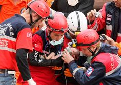 Rescue workers carry Azra Karaduman, a two-week-old baby girl, from a collapsed building in Ercis, near the eastern Turkish city of Van, on October 25, 2011. The baby was rescued alive from the rubble of a collapsed building on Tuesday, 46 hours after an earthquake struck southeast Turkey, a Reuters Television journalist said. Her mother, Semiha, who was also rescued, had been clasping her daughter to her chest. (Reuters/Stringer)