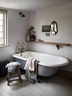 Drift away from the everyday with this Scandi inspired bathroom idea. Accessorise the grey freestanding bath with washed linen towels and a feature shelf with sprays of eucalyptus.