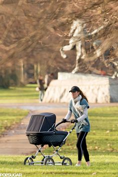 Catherine, Duchess of Cambridge is seen  pushing Prince George in a pram in a London park on Feb. 13, 2014.