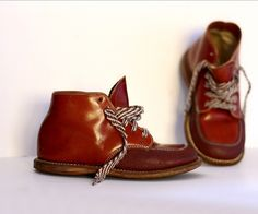 we have little shoes like these we got in a vintage shop in bisbee, az.  each of our kids have worn them... tres adorable!