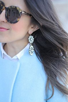 Tortoise Sunglasses + Statement Earrings + Light Blue Coat