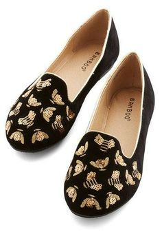 // gold bees made from sequins, on a black smoking slipper...this is everything.