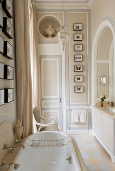 classic English country styled bathroom... elegant and simple - (interesting display of FRAMES near door - /B.)