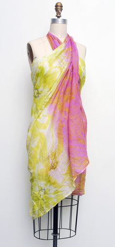 Elizabeth Gillett Kona Scarf/Pareo - Pink Summer perfection all in one accessory! Elizabeth Gillett's soft cotton feels wonderful, and this gorgeous print is summer itself! Such fresh color! Add to all that the versatility factor, you can wear this piece any way you want. As a beautiful scarf, a stylish wrap, or a sassy pareo skirt or dress! Swath your self in color and beauty, any way you want! http://www.melange4women.com/elgikoscpi.html