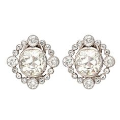 Old Mine Cut Diamond Earclips with Diamond Surround   From a unique collection of vintage clip-on earrings at http://www.1stdibs.com/jewelry/earrings/clip-on-earrings/