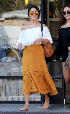 Vanessa Hudgens matches her boho orange skirt with her retro round shades, and we have new style goals.