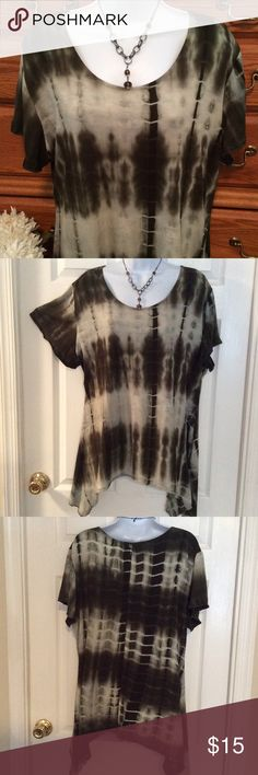 """Shannon Ford New York Green Tie Dye Shark Bite Hem 95% rayon and 5 % spandex.  Very good condition.  Approximately 28"""" in length but the shark bite hems take it down to 34"""" in length.  Feels like a thicker t-shirt with spandex..  Just a fun and comfy tunic.  Darker olive green color. When laid flat and measured from armpit to armpit it is 23"""" across.  Has stretch. Nice flow. Shannon Ford New York Tops Tunics"""