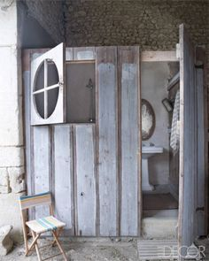A round window - how fine. Mathilde Labrouche Home in Southwestern France - Century French Farmhouse - ELLE DECOR Wooden Bathroom, Rustic Bathrooms, Bathroom Vintage, Bathroom Ideas, Barn Bathroom, Budget Bathroom, Washroom, Bath Ideas, Wabi Sabi