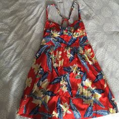 Floral Hollister dress Red, blue, white & yellow floral dress. For some reason it looks like I cut the size tag off of the dress. But it's definitely a small or medium. Hollister Dresses