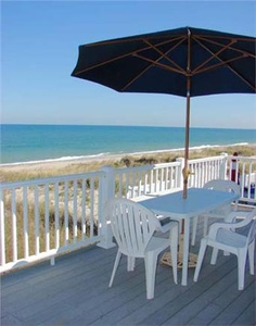 Could you envision yourself enjoying a cocktail on this large deck overlooking the beach in this Sandwich vacation rental on Cape Cod?