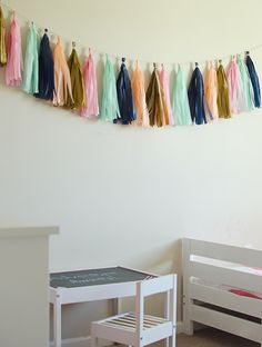 modern navy, coral, and gold bedroom; toddler girls room, modern toddler bedroom, tissue paper garland, modern bedroom decor